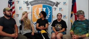 students answer questions about school for dog trainers