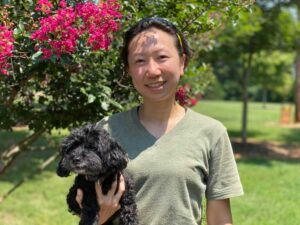 christine ho with black dog